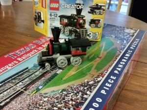 A Lego steam engine and a 1000-piece puzzle that my wife bought me to cheer me up.
