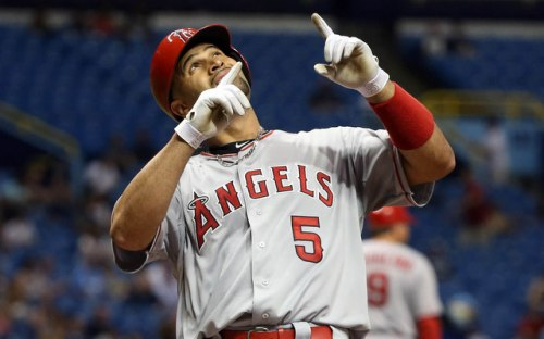Jun 9, 2015; St. Petersburg, FL, USA; Los Angeles Angels first baseman Albert Pujols (5) reacts at home plate after he hit a solo home run during the fifth inning against the Tampa Bay Rays at Tropicana Field. Mandatory Credit: Kim Klement-USA TODAY Sports