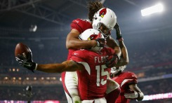 GLENDALE, AZ - DECEMBER 10: Wide receiver Michael Floyd #15 of the Arizona Cardinals celebrates with wide receiver Larry Fitzgerald #11 after scoring a 42 yard touchdown during the third quarter of the NFL game against the Minnesota Vikings at the University of Phoenix Stadium on December 10, 2015 in Glendale, Arizona. (Photo by Christian Petersen/Getty Images) ORG XMIT: 587447613 ORIG FILE ID: 500863982