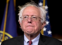 """Sen. Bernie Sanders, I-Vt., participates in a news conference on Capitol Hill in Washington, Wednesday, April 29, 2015. Sanders will announce his plans to seek the Democratic nomination for president on Thursday, presenting a liberal challenge to Hillary Rodham Clinton. Sanders, an independent who describes himself as a """"democratic socialist,"""" will follow a statement with a major campaign kickoff in his home state in several weeks. Two people familiar with his announcement spoke to The Associated Press under condition of anonymity to describe internal planning. (AP Photo/Carolyn Kaster)"""